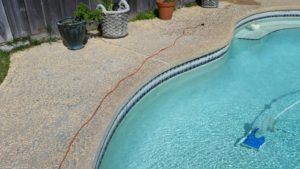 A picture of dirty tile. (Before) Bay Area Pool Tile Cleaning